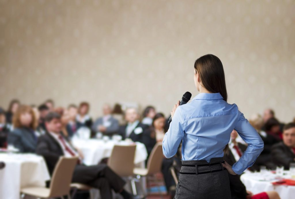 Woman speaking to audience