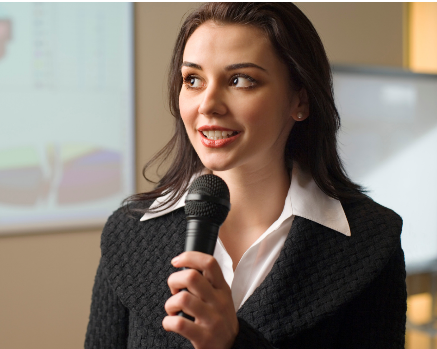 Woman timidly speaking into microphone