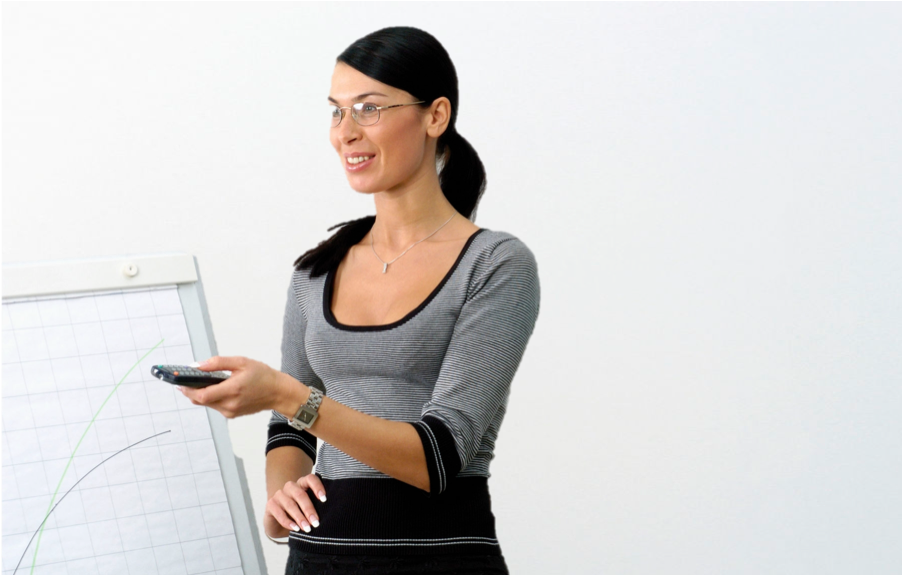 Woman using remote during business presentation