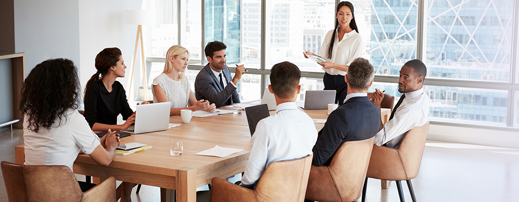 Formal business meeting with woman public speaking